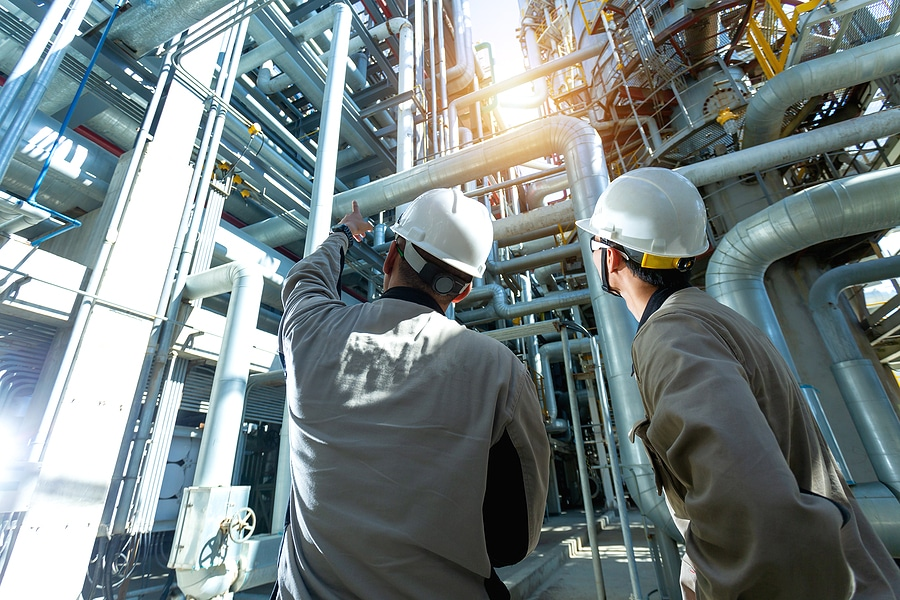Industrial Engineer Or Worker Checking Pipeline At Oil And Gas R